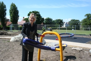 Our Chairman, Esther Mcvey  checks out the new see-saw and the Supernova in the background