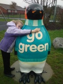 P...Pick up a Penguin. Ellen gives Go Green a Big Hug