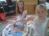 Ellen and Charlotte making part of the mosaic