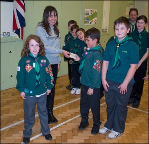 Rachel receives cheque from the Cubs